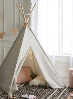 Simons Maison exclusive A perfect hiding spot for kids, this cute ivory tent will be their favourite place to hang out and play.