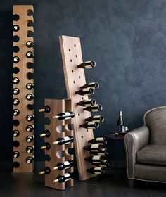A sculptural tower of beautiful European oak, our show-stopping, solid wood standing wine rack holds a dozen bottles in artfully shaped notches. Skillfully carved to bring out the natural color and gorgeous graining of solid wood, each beam traces its origins to a single forest. In fact, customers will receive a signed and dated tag to follow the production history on a special website.