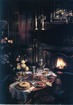 Late night treats by the fireplace. Dark and romantic.
