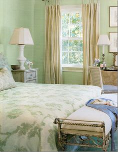 Soft green walls, striped curtains, toile bedding--my style