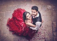 New Pre Wedding photoshoot ideas for Indian Weddings | Creative pre wedding photoshoot inspirations | Indian couples | Flower shower | Shot from the top | Bride in Red gown | Photo Credits: JJ WeddingZ | Every Indian bride's Fav. Wedding E-magazine to read. Here for any marriage advice you need | www.wittyvows.com shares things no one tells brides, covers real weddings, ideas, inspirations, design trends and the right vendors, candid photographers etc.