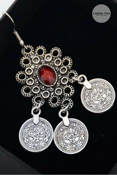 Accessorize // Dazzle your outfit by adding this silver ruby and coin chandelier earrings to the mix.