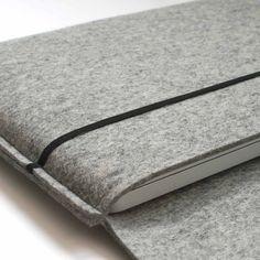 wool felt MacBook sleeve in gray - via manongarritsen.com