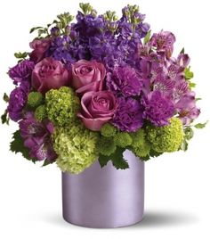 Shades of purple & magenta with a touch of lime green set in this lavendar metallic container really brings out the complimentary colors & choices of flowers.