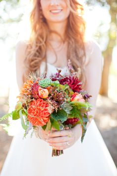orange/red/green bouquet with purple and magenta bridesmaid dressessss? :D
