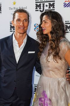 Pin for Later: Matthew McConaughey and Camila Alves Have Years of Adorable Moments  Camila laughed with her husband Matthew at an Austin, TX charity event in April 2013.