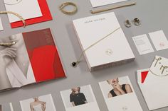 Logo, stationery and print with a gold and red spot colour detail designed by ico for jewellery brand Mark Milton