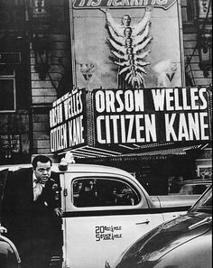 Orson Welles outside of a theatre playing ...his own movie! What a great image!