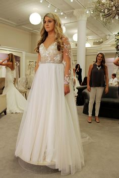 Season 14 Featured Dress: Danielle Caprese. Long lace sleeves, low v neck, beaded belt at waist, long flowy skirt. $3,200.