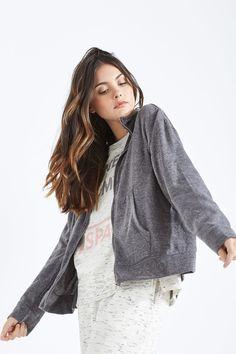 Veste simple à manches longues, col cheminée avec poches, fermeture éclair. Belle et à laise. | Cardigans | women'secret