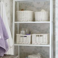 Invest in an inexpensive freestanding shelf unit to load up with baskets filled with all your bathroom essentials. Photography: Mark Scott. Find more bathroom ideas at housebeautiful.co.uk
