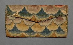 Pocketbook, Winterthur, 1700-1775, linen, canvas, wool, silk, cardboard, 3.75 x 7 inches, accession number 1959.2594
