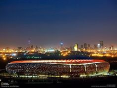 The stunningly dramatic FNB Stadium in Johannesburg, South Africa Soccer City, Soccer Stadium, Football Stadiums, Night City, Africa Travel, Countries Of The World, South Africa, Around The Worlds, Stadium Architecture