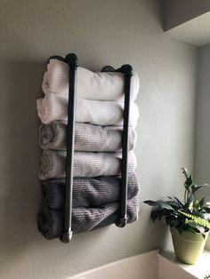 17 Best Bathroom Towel Rack Ideas and Towel Hangers for your Bathroom Amazing bathroom towel train r Bathroom Towel Storage, Bathroom Towels, Bathroom Closet, Towel Hangers For Bathroom, Master Bathroom, Bathroom Fixtures, Bath Towel Racks, Relaxing Bathroom, Bathroom Rack