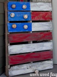 old pallet painted as flag with baseballs attached...so easy and great for a garden or porch