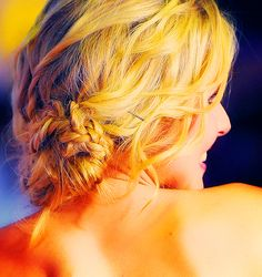 Loose, curly updo with accent braids for medium to long hair, seen here on Kristen Bell.