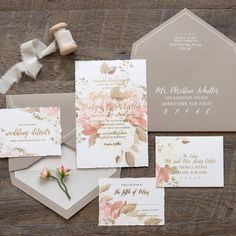 """Romantic and elegant, Katherine is perfect for a garden or formal wedding. This 6"""" x 9"""" one-ply invitation features deckled edges, a captivating muted floral print and a light-hearted metallic script font."""