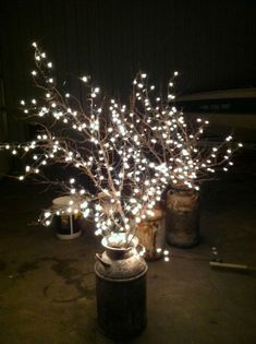 old milk can, branches, and white lights - (can use any tall vessel)