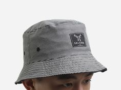 Mindnight Reversible Bucket Hat by Kaledra. It's like two bucket hats in one! Navy blue color and gray color, Kaledra logo patch. Switch it around to better suit the mood you're in. Perfect for sunny days out or your beach holidays. http://www.zocko.com/z/JJ3Po