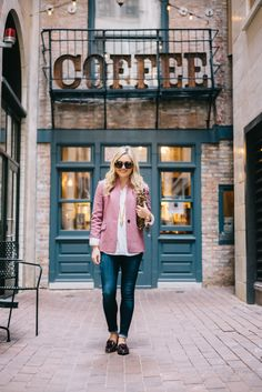 d9f31d073fa Fashion blogger Bows  amp  Sequins styling a pink blazer and jeans in  downtown Chicago.