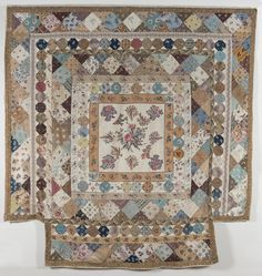 Frame quilt with broderie perse center and snowball block border; 1830-1850; Quilt Museum, York.
