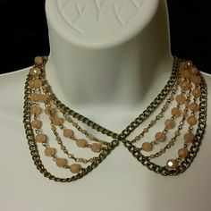 """Vintage Statement Piece Gorgeous Vintage looking necklace, Certain angles make it look like a large butterfly. Silvertone with gorgeous light pink beads. The pictures just can't do this justice. Please see photo 4 to get an accurate color. Approximately  21"""" in length. Nice heavy piece. Jewelry Necklaces"""