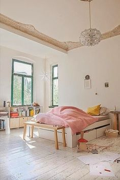 Interesting room. I like the pink spread on the bed.