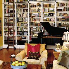 Bookshelf, sliding ladder and grand piano.
