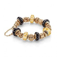 Luscious glass, gold & silver beads by Pandora make a striking bracelet! Tax Free at Jewelry Studio in Montana! www.bozemanjewelry.com