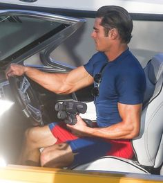 Zac Efron Photos - Zac Efron and Dwayne the Rock Johnson were spotted on set of 'Baywatch' at Boca Raton in Palm Beach, Florida on February 22, 2016.   The group was ready to film on the boat, however it appears as though Zac's shirt is a bit too small for him and reveal his very patriotic underwear. - Zac Efron & The Rock on the Set of 'Baywatch' in Florida