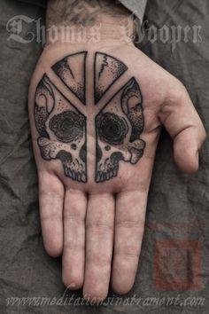 Thomas Hooper --- peace sign skull palm tattoo