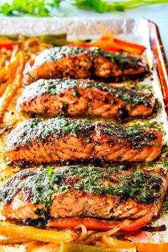 So Easy Sheet Pan Fajita Salmon w/Cilantro Lime Butter - the best I've ever tried! SO flavorful and juicy and the Cilantro Lime Butter is incredible! I serve this with rice and beans for a complete easy, delicious meal! Baked Salmon Recipes, Fish Recipes, Seafood Recipes, Dinner Recipes, Fish Dishes, Seafood Dishes, Main Dishes, Grilling Recipes, Cooking Recipes