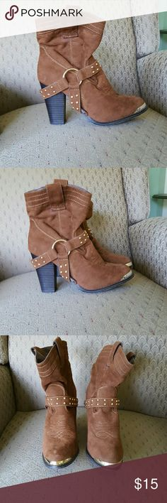 Heeled brown and gold detail booties Super cute heeled boots are brown faux suede material on the outside with dark brown leather on the inside and gold detail on front toes and on the loop and studds. These are in good condition and are a cute piece to add to an outfit. Some scratches on back of heels and front of thr bottom soles. Bottom of shoes are scratched as well. Otherwise, these flaws are not so noticeable as its mostly just the bottoms that show some signs of wear. Shoes Heeled…
