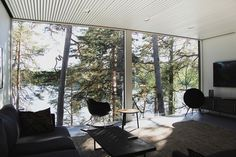 Sunhouse - Modern prefab homes. This modern prefab house is located in the archipelago of Helsinki, in Finland. Modern Prefab Homes, Peaceful Home, Lakeside Cottage, Weekend House, Cabins In The Woods, Porch Swing, Interior And Exterior, House Design, Architecture