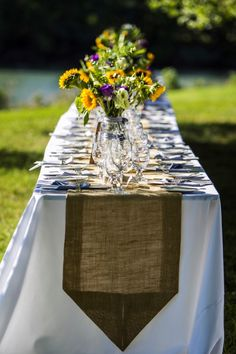 Banquet tables with burlap runners and sunflowers. FRom Erika & Dave's offbeat, outdoors Maryland wedding at Woodlawn Farm with sunflowers! Images by Andrew Morrell Photography.