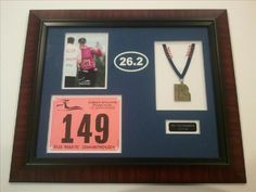 Framing Idea # 25 - Frame your medals, pics, numbers, etc from your sporting events. Such as.... your Mardi Gras Marathon memorabilia. Congrats to everyone who ran this weekend!