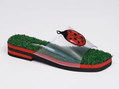 "Andrea Pfister, ""Ciabatta"" wedge in red and black with vinyl ladybug on micro green meadow, 2001. Collection: Diffusion APD 206. © Centro Interdipartimentale MIC ""Moda Immagine Consumi"" - Università degli Studi di Milano. Source: unimi.it"