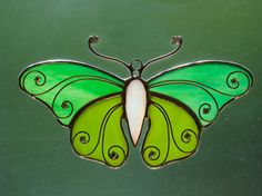 Grab your butterfly net and dont let this one get away! This sparkling little beauty has it all - a mother of pearl, irridescent white body with two-toned green filligree wings and AB crystal accents.    Handmade using Tiffanys copper-foil method of stained glass.    Measurements: Approximately 6 5/8 x 3 3/4    Shipping price is for the US only. Feel free to e-mail me for a shipping quote outside of the US.    *´¨)  ¸.•´ ¸.•*¨)  (¸.•´ ¤ Ƹ̴Ӂ̴Ʒ Please see my store for more stained gla...