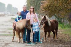 Two little ponies with their adorable family.
