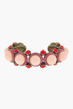 Lanvin Coral Pearl Crystal Accented Cuff -  Lanvin Coral Pearl Crystal Accented Cuff Lanvin Cuff style bracelet with oversize faux pearl embellishments in coral. Fuchsia glass accents around pearls with larger red glass accents at sides. Approx 0.7 width. 1.5 opening. Price $780.00 Click HERE for more Information