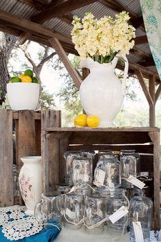 cream flowers, wooden boxes, mason jar cups.