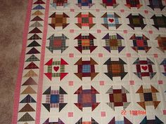 Plaid and scrappy churn dashes with flying geese border, from http://juliekquilts.blogspot.com/2012/10/one-thing-leads-to-another.html