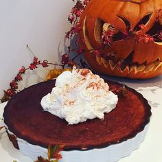 Pumpkin pie with whipped cream. Carved Scary pumpkin.