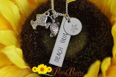 """❤ BEACH GIRL NECKLACE DESCRIPTION: Hand-stamped necklace with """"BEACH GIRL"""" stamped on the long tag and a starfish on the other. Necklace has 2 charms that are hung on the size of the stamped pieces.   ❤ DISC SIZES/MATERIALS: The rectangle tag is 1 3/8"""" long and round disc is 1/2"""", both made of stainless steel. #metaljewelry #charmnecklace #prettyprairiedesigns"""