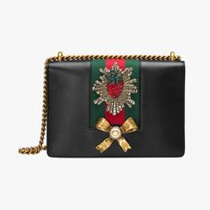 Gucci leather chain shoulder bag, $2,390 Buy it now