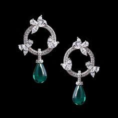 Unique in design, these stud earrings feature an emerald tear drop charm hanging on a circle of floral accents and pave set cubic zirconia stones in sterling silver.