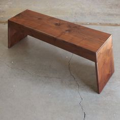 The bench is crafted from solid wood and constructed using traditional shouldered lap joints