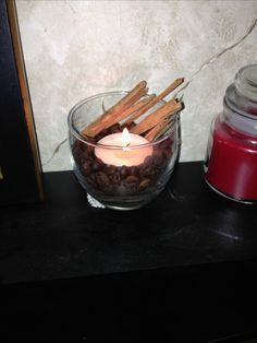 Glass vase with a vanilla candle, French vanilla whole coffee beans and cinnamon... My house smells delicious. :)