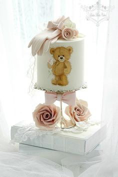 Delicate pink peony ruffles, striking rose sugar flowers, exquisite piped lace patterns, hand-painted teddy with roses, gloves and lace, these brilliant wedding cakes from Leslea Matsis Cakes are too pretty to eat!