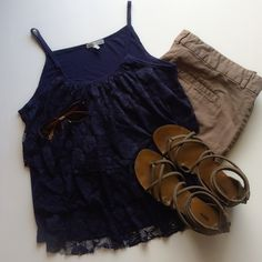 Charlotte Russe navy layered lace tank Very gently used navy blue tank with layered lace detail on front.  Backside is plain cotton.  Wore only a couple times and no signs of wear.  Very comfortable and front is lined so you cannot see through it.  100% Rayon.  Comes from a smoke free and pet free home.  Open to offers.  Please no trades or paypal. Charlotte Russe Tops Tank Tops
